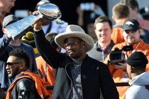 Super Bowl MVP Von Miller hoists the Lombardi Trophy via The Denver Post