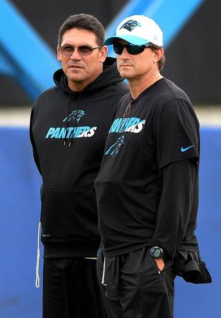 Panther's Head Coach Ron Rivera (Left) & Offensive Coordinator Mike Shula (Right) via charlotteobserver.com