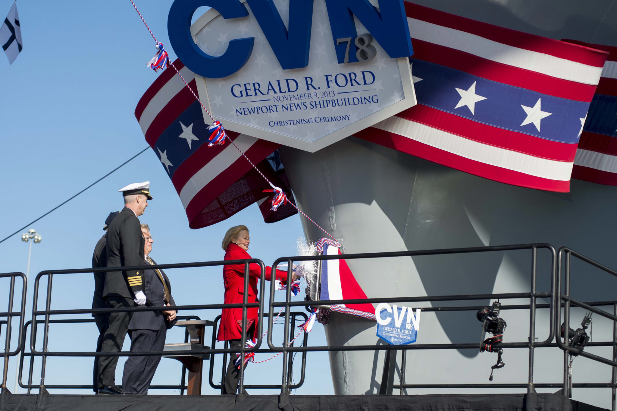 131109-N-WL435-911 NEWPORT NEWS, Va. (Nov. 9, 2013) Susan Ford Bales, daughter of former President Gerald R. Ford and sponsor of the aircraft carrier that bears his name, breaks a bottle of champagne on the bow of the aircraft carrier Gerald R. Ford (CVN 78) at Newport News Shipbuilding during the christening ceremony for the Ford. The first in class, Ford-class aircraft carrier, is scheduled to join the fleet in 2016. (U.S. Navy photo by Chief Mass Communication Specialist Peter D. Lawlor/Released)