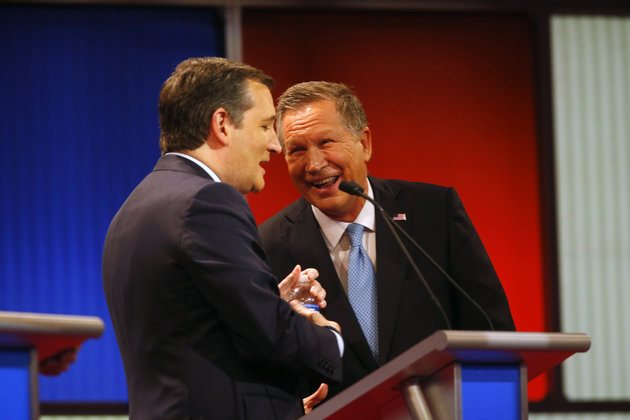 Republican presidential candidate, Ohio Gov. John Kasich , right, laughs with Sen. Ted Cruz, R-Texas, during a Republican presidential primary debate at Fox Theatre, Thursday, March 3, 2016, in Detroit. (AP Photo/Paul Sancya)