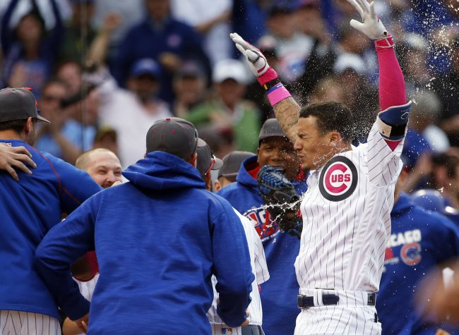 Chicago Cubs' Javier Baez, right, celebrates with teammates after hitting a baseball game-winning solo home run against the Washington Nationals during the 13th inning Sunday, May 8, 2016, in Chicago. (AP Photo/Nam Y. Huh)